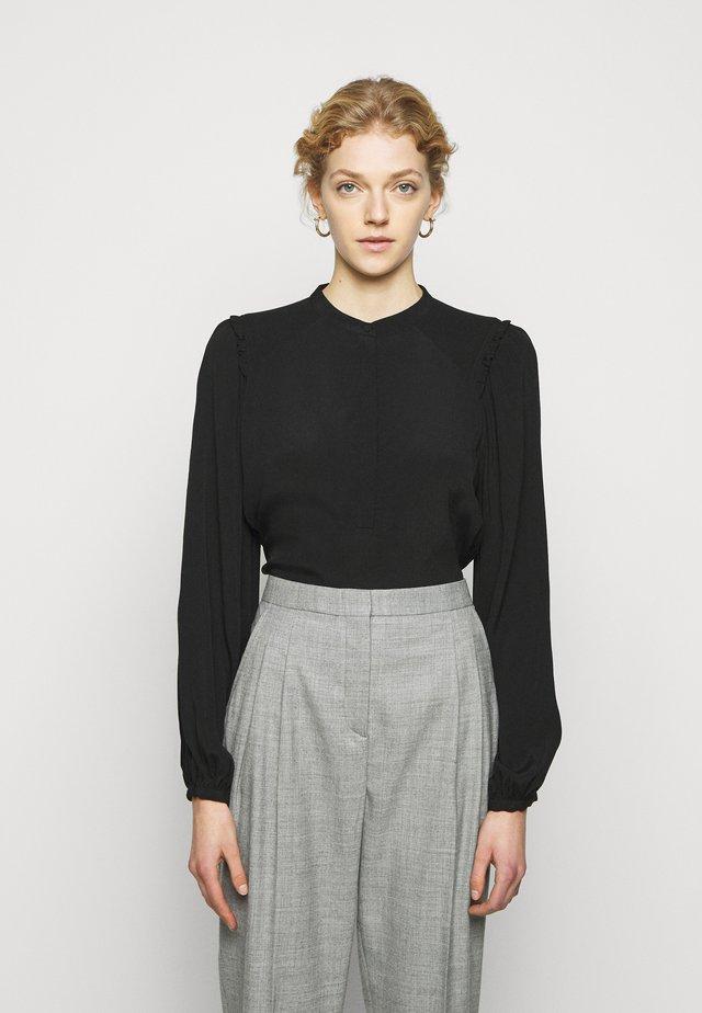 LILLI MIELA - Bluse - black