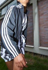 adidas Originals - TRACK - Training jacket - black - 2