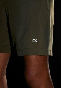 Calvin Klein Performance - SHORT - Sports shorts - green - 4