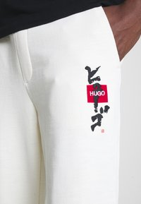 HUGO - DOHAGI - Tracksuit bottoms - natural - 5