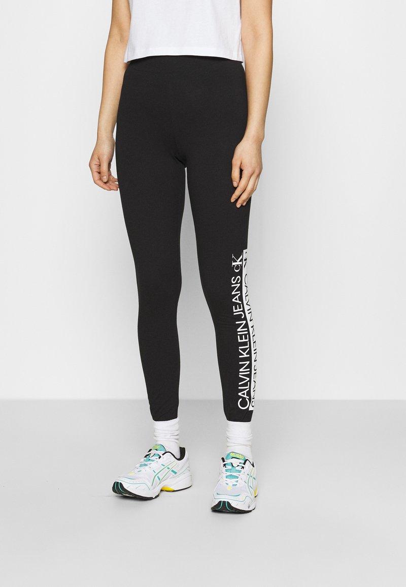 Calvin Klein Jeans - MIRRORED LOGO - Leggings - Trousers - black