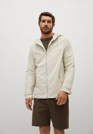 Korte jassen - gris clair pastel