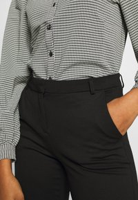 Vero Moda - VMLILITH MR ANKLE PANT - Trousers - black - 4