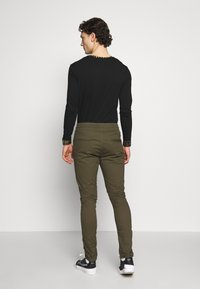 Blood Brother - RUCHED LEG TROUSERS - Tygbyxor - khaki - 2