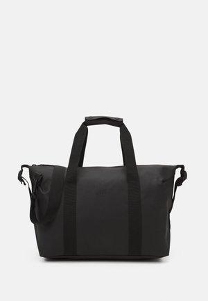 WEEKEND BAG SMALL UNISEX - Weekend bag - black