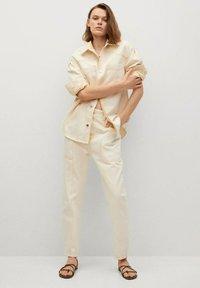 Mango - Button-down blouse - pastelgeel - 1