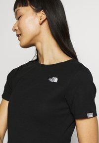 The North Face - WOMENS SIMPLE DOME TEE DRESS - Žerzejové šaty - black - 4