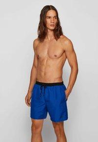 BOSS - STARFISH - Swimming shorts - open blue - 0