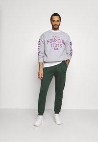 Nike Sportswear - Tracksuit bottoms - galactic jade/sequoia/galactic jade/sequoia - 1