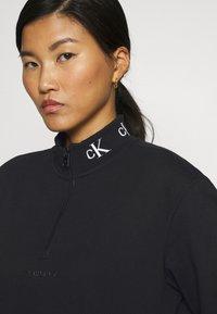 Calvin Klein Jeans - LOGO TRIM MOCK NECK ZIP DRESS - Day dress - black - 4