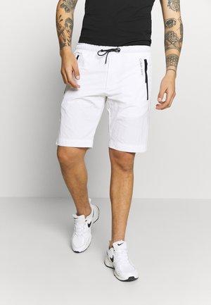 REGULAR FIT CRINKLE - Pantalon de survêtement - white