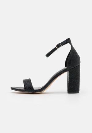 BEELLA - Sandály na vysokém podpatku - black