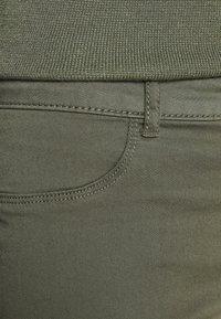 NAF NAF - POWER SKINNY - Trousers - marais - 3