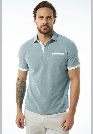 BRENNO - Polo shirt - indigo