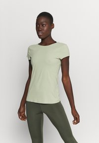 Nike Performance - THE YOGA LUXE - T-shirts - celadon/olive aura - 0