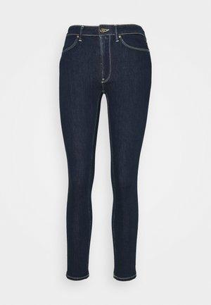 IRIS - Slim fit jeans - blue denim