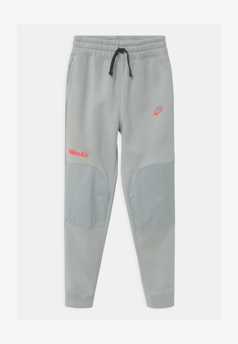 Nike Sportswear - AIR - Tracksuit bottoms - light smoke grey/bright crimson