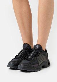adidas Originals - THESIA  - Trainers - core black/footwear white - 0