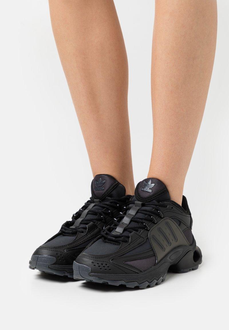 adidas Originals - THESIA  - Trainers - core black/footwear white