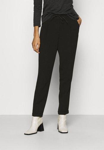 MIEKA - Trousers - black