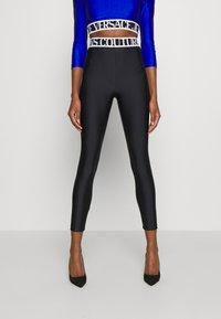 Versace Jeans Couture - PANTS - Leggings - Trousers - black - 0