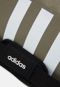 adidas Performance - ESSENTIALS 3 STRIPES SPORTS DUFFEL BAG UNISEX - Sports bag - legend green/black/white - 4