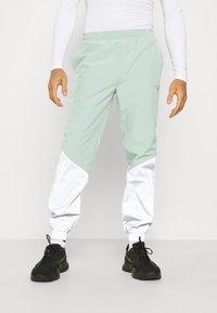 Hi-Tec - FREDERICK REFLECTIVE TRACK PANTS - Trousers - granite green - 0