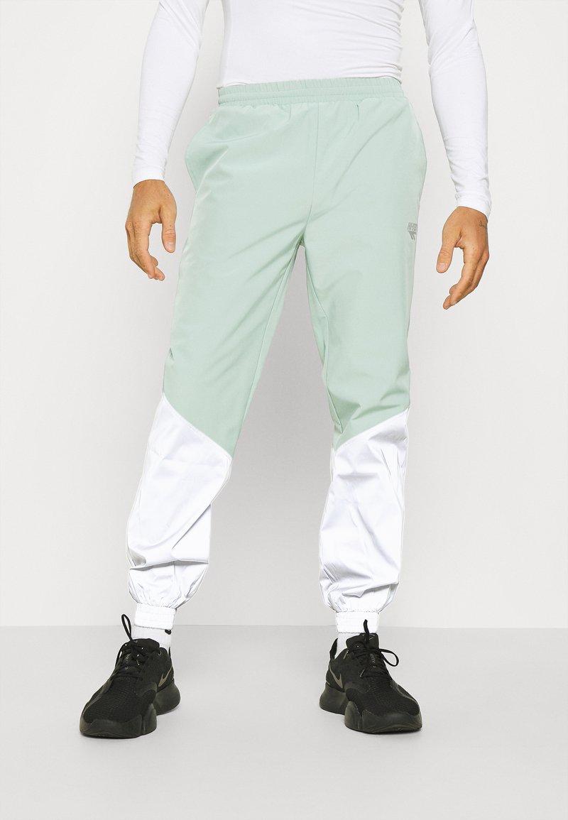 Hi-Tec - FREDERICK REFLECTIVE TRACK PANTS - Trousers - granite green