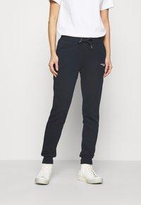 Armani Exchange - PANTALONI - Teplákové kalhoty - navy - 0