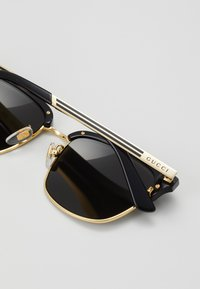Gucci - Sunglasses - black/gold-coloured/grey - 2
