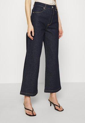 WINNIE - Jeans a zampa - dark denim