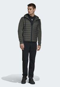 adidas Performance - VARILITE HYBRID  - Sports jacket - green - 1