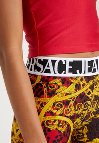 Versace Jeans Couture - LADY FUSEAUX - Leggings - racing red - 4