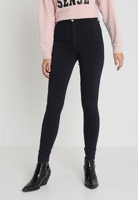 Pieces - PCHIGHSKIN WEAR  - Jeans Skinny Fit - navy blazer - 0