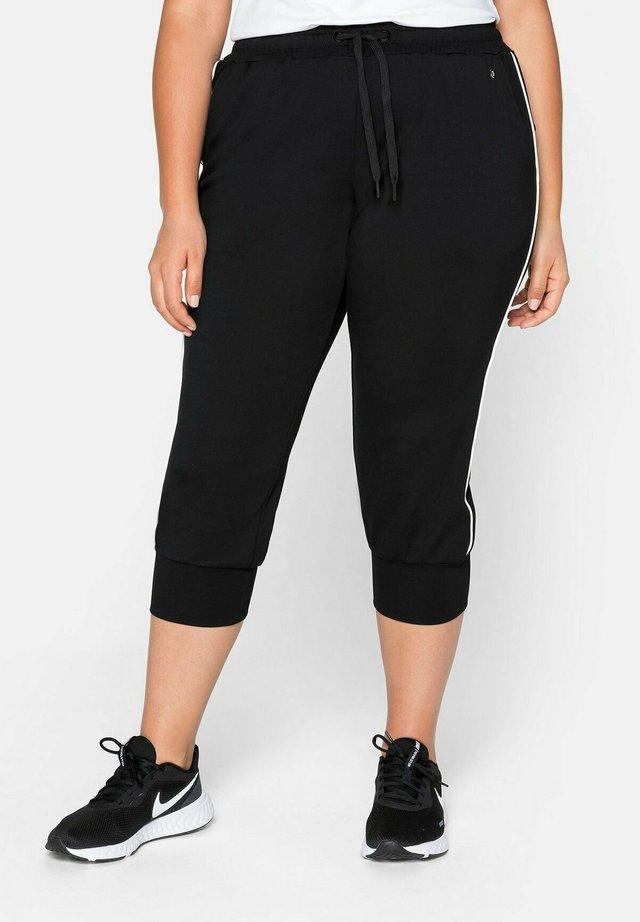 Pantaloncini sportivi - schwarz