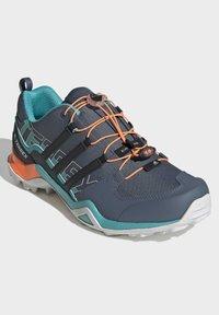 adidas Performance - TERREX SWIFT R2 HIKING SHOES - Hiking shoes - green - 3