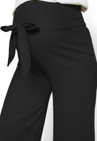 LOVE2WAIT - PANTS CRINCLE - Trousers - black - 4