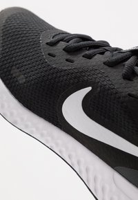 Nike Performance - REVOLUTION UNISEX - Neutral running shoes - black/white/anthracite - 2