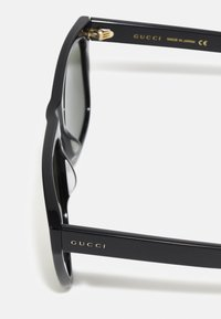 Gucci - UNISEX - Sunglasses - black/black/green