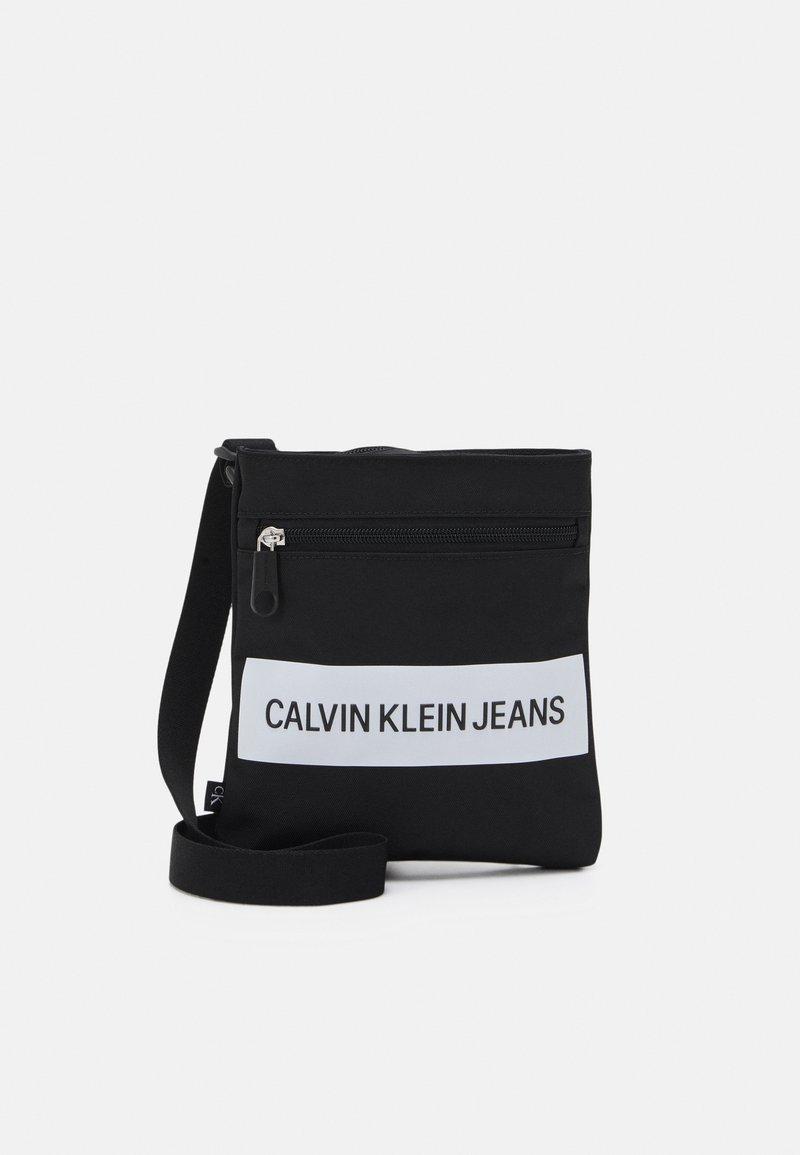 Calvin Klein Jeans - MICRO FLATPACK UNISEX - Across body bag - black