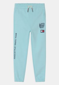 Tommy Hilfiger - COOL GRAPHIC - Tracksuit bottoms - frost blue - 0