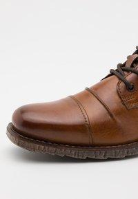Bugatti - SATURINO - Lace-up ankle boots - cognac - 5