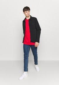adidas Originals - ESSENTIAL TEE UNISEX - Basic T-shirt - lusred - 1