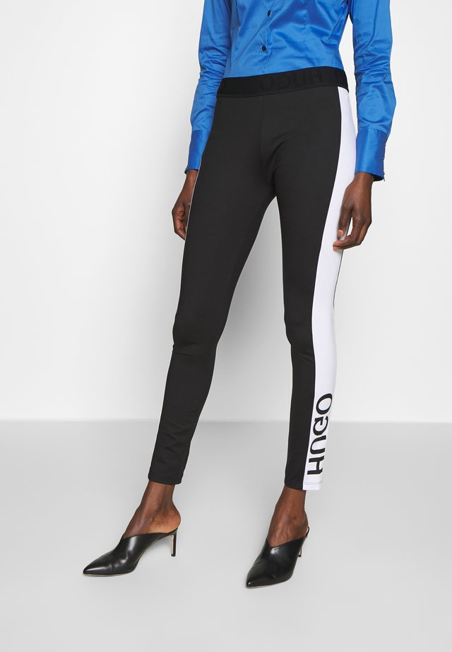 NOURY - Leggings - black
