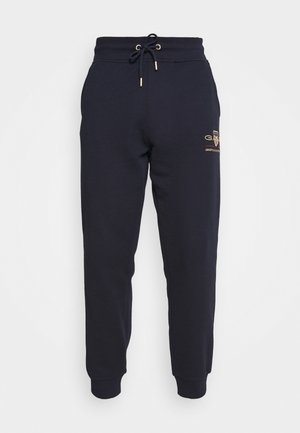 ARCHIVE SHIELD  - Tracksuit bottoms - evening blue