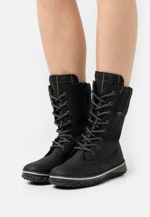 Winter boots - schwarz/gold