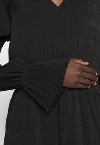 Holzweiler - RICA PLEAT DRESS - Day dress - black - 4