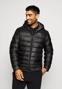 Patagonia - HOODY - Down jacket - black - 0