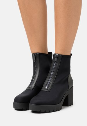 ROXANNA - Platform ankle boots - black