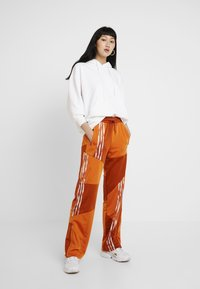 adidas Originals - DANIELLE CATHARI JOGGERS - Trousers - fox red - 2